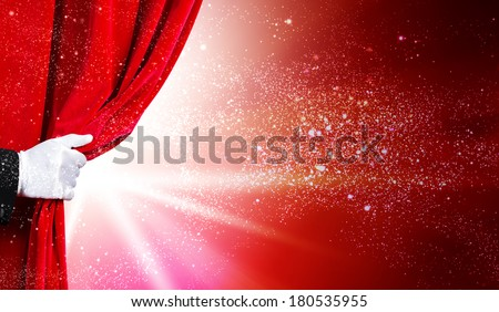 Human hand in white glove opening red velvet curtain - stock photo