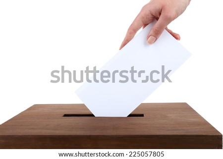 Human hand inserting envelope in mailbox isolated on white