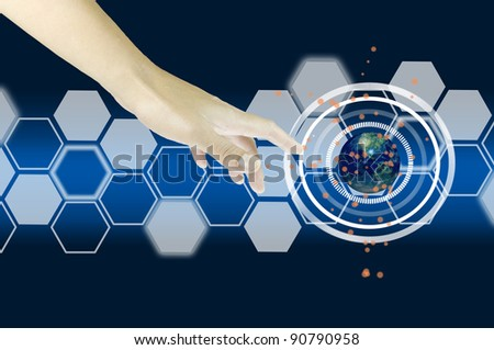 Human hand interacting with an earth globe in advanced digital interface - stock photo