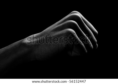Human hand is drawn by light on a black background - stock photo