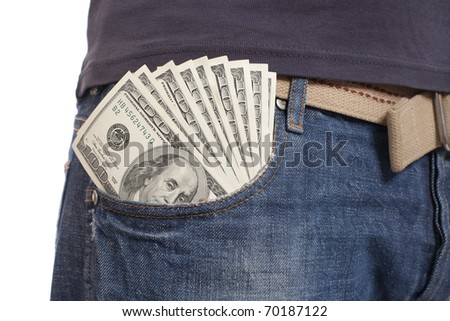 human hand is putting money in the pocket - stock photo