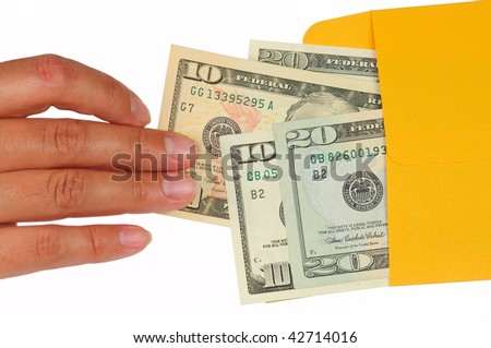 Human hand is taking out money from a yellow envelope. Isolated on White. - stock photo