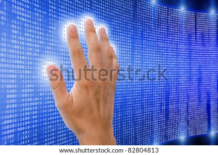 human hand is touching digital matrix that starts to shine and radiate energy - stock photo