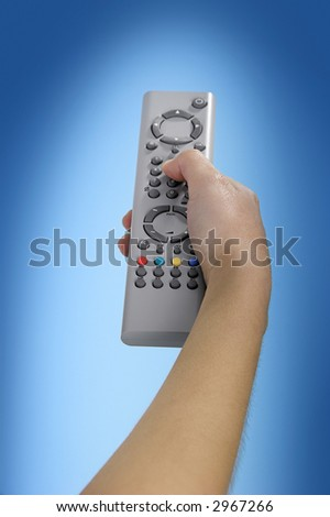 Human hand olding a tv remote control - stock photo