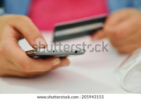 Human hand on tablet pc and credit card for shopping online - stock photo