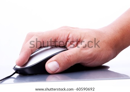 Human hand operating a computer mouse on a reflective surface - stock photo