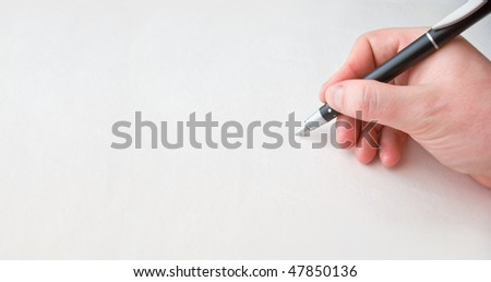 Human hand over white paper with pen - stock photo