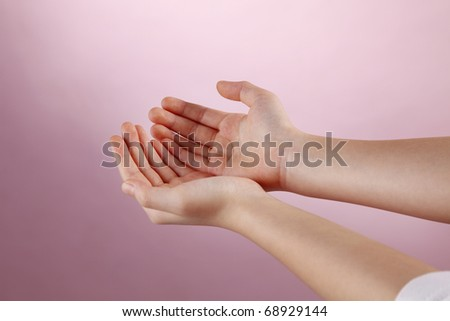 Human hand performing begging gesture. - stock photo