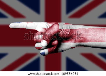 Human hand point with finger in United Kingdom national flag