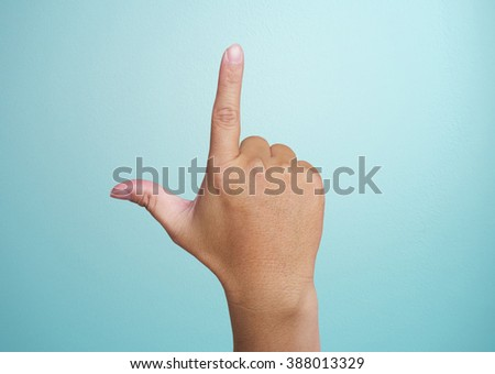 Human hand point with finger isolated on blue. - stock photo