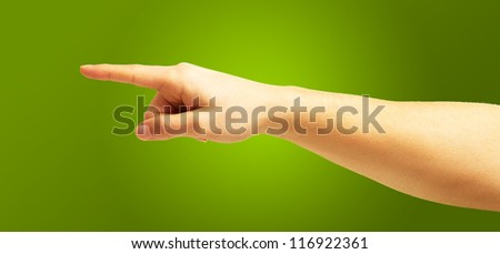 Human Hand Pointing On Green Background - stock photo