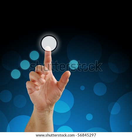 human hand pressing a virtual button in a touchscreen of a modern display - stock photo