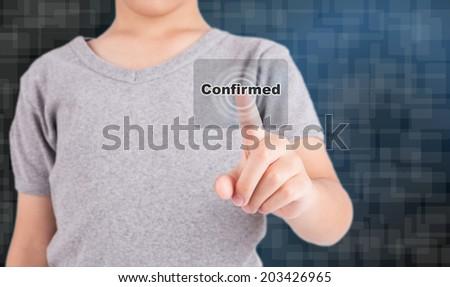 "human hand pressing virtual button ""confirm"" on virtual touchscreen - stock photo"