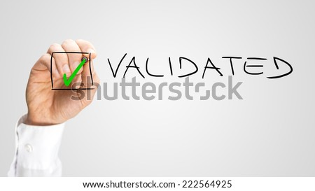 Human Hand Putting Green Check Inside Box for Validated Option, Isolated on Gray Background. - stock photo