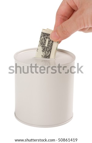 Human hand putting money in the coin box. Concept of savings or charity. - stock photo