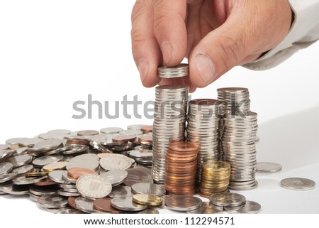 Human hand rising coins - isolated in white