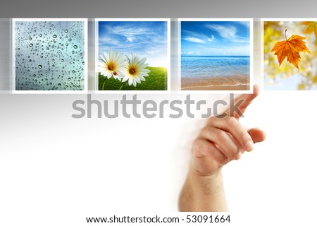 human hand scrolling images in a touch screen of a modern display - stock photo