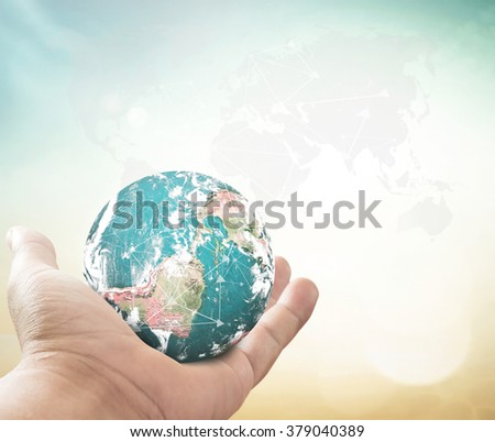 Human hand showing planet over blurred world map of clouds background. World Environment, Eco Friendly, Save, CSR, Trust, Earth Hour, Love, Business concept. Elements of this image furnished by NASA. - stock photo