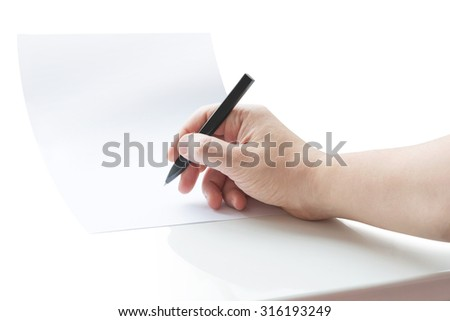 Human hand signing blank white sheet of paper using pen - stock photo
