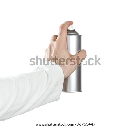 Human hand spraying with paint over white background - stock photo