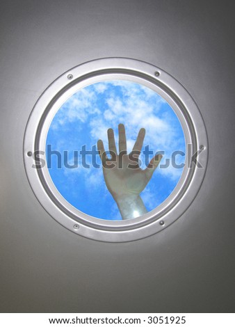 human hand, through the window  of  airplane