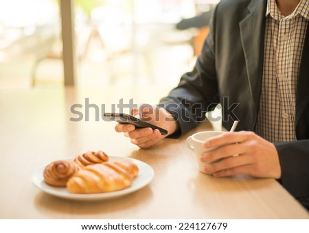Human hand touches the screen a modern smartphone - stock photo