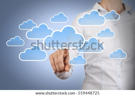 Human Hand Touching Cloud Computing Concept on Visual Screen