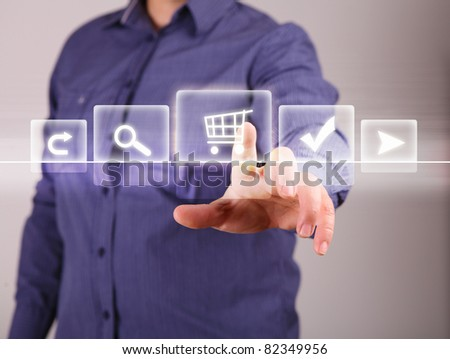Human hand touching screen with buttons on it - stock photo