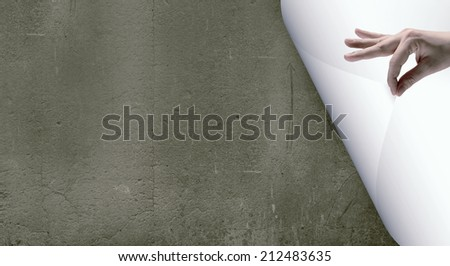 Human hand turning white blank paper page