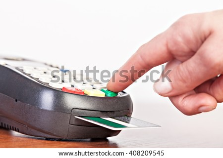 Human hand  using payment terminal, credit card reader.Studio shot. Selective Focus. - stock photo