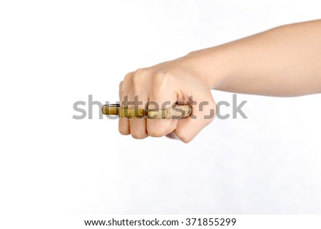 Human hand  wearing brass knuckles on white background.Knuckle weapons