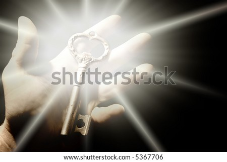 Human hand with an old key - stock photo