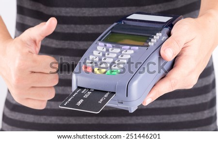Human Hand With Credit Card Machine - stock photo