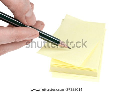 Human hand with pencil write on yellow memories sticker. Clipping path. - stock photo