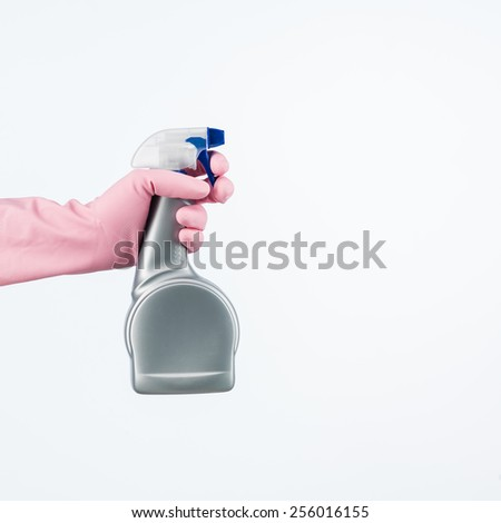 human hand with protective glove holding cleaning spray bottle. isolated on white - stock photo