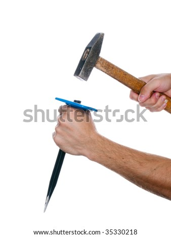 Human hand working with chisel tool and hammer - stock photo