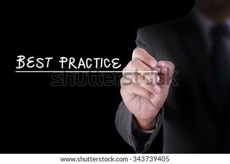 human hand write BEST PRACTICE on black virtual screen board for business internet communication social media or advertising and quality control for organization company school and university - stock photo