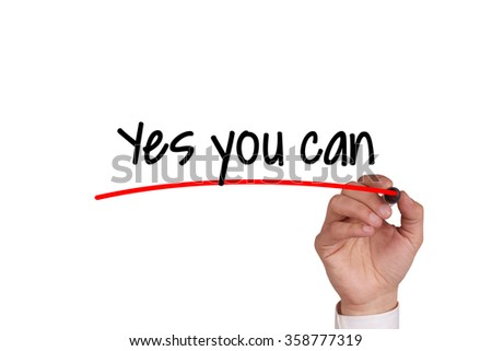 Human hand writing YES YOU CAN on whiteboard - stock photo