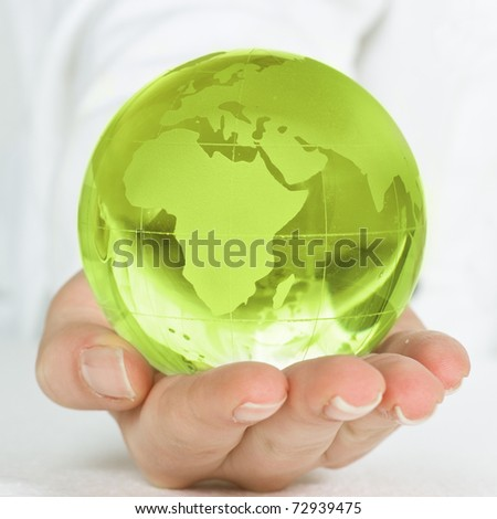 Human hands care about planet. - stock photo