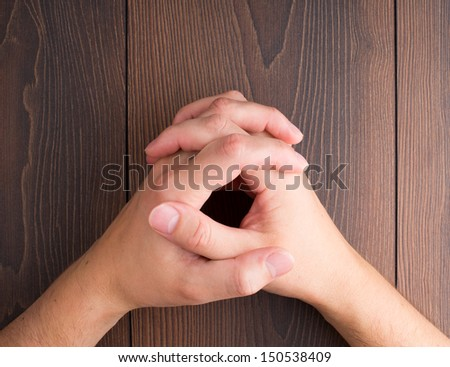Human hands clasped - stock photo