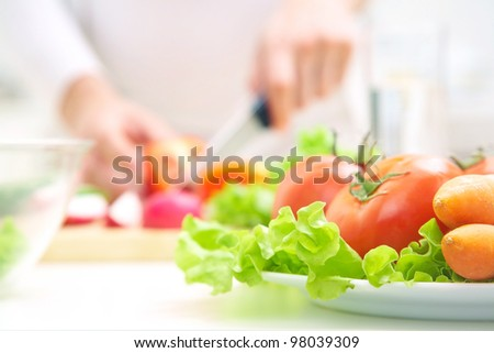 Human hands  cooking vegetables salad in kitchen - stock photo
