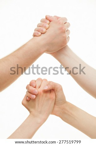 Human hands demonstrating a gesture of a strife or solidarity, white background - stock photo