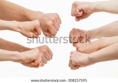 Human hands demonstrating a gesture of a strife, white background