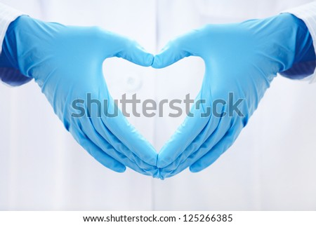 human hands folded in the form of the heart - stock photo