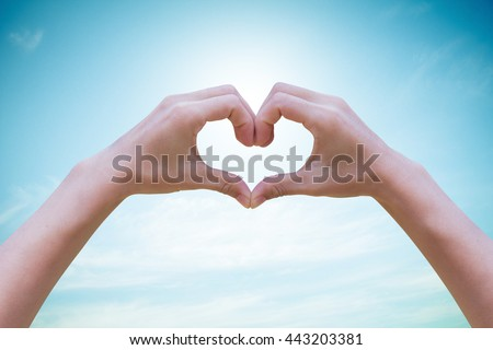Human hands Heart shaped the sky in the background blurred.Environment Day concept. Ecology concept. .Environment Day concept.Ecology concept.The power harmonious