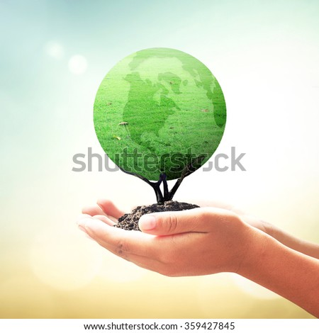 Human hands holding a green earth of grass over blurred beautiful sunset background. Ecology, World Environment Day, Investment, CSR, Health Care, Healthcare, Insurance Agent, Organ Donation concept - stock photo