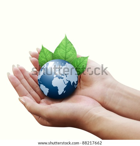 human hands holding blue earth with a leaf isolated on white background