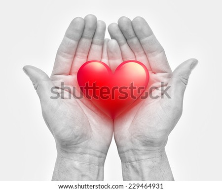human hands holding heart - stock photo