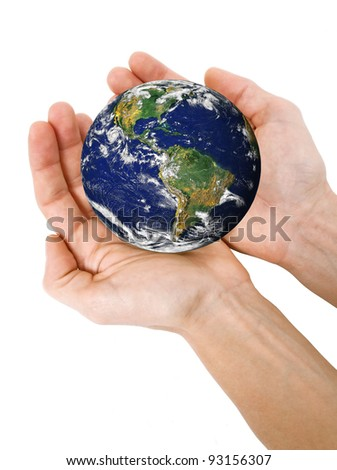 Human hands holding planet Earth
