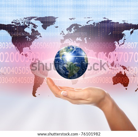 human hands holding planet earth with digital symbols around